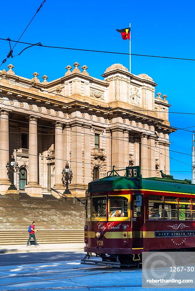 A classic tram goes past Parliament House in Melbourne, Victoria, Australia, Pacific
