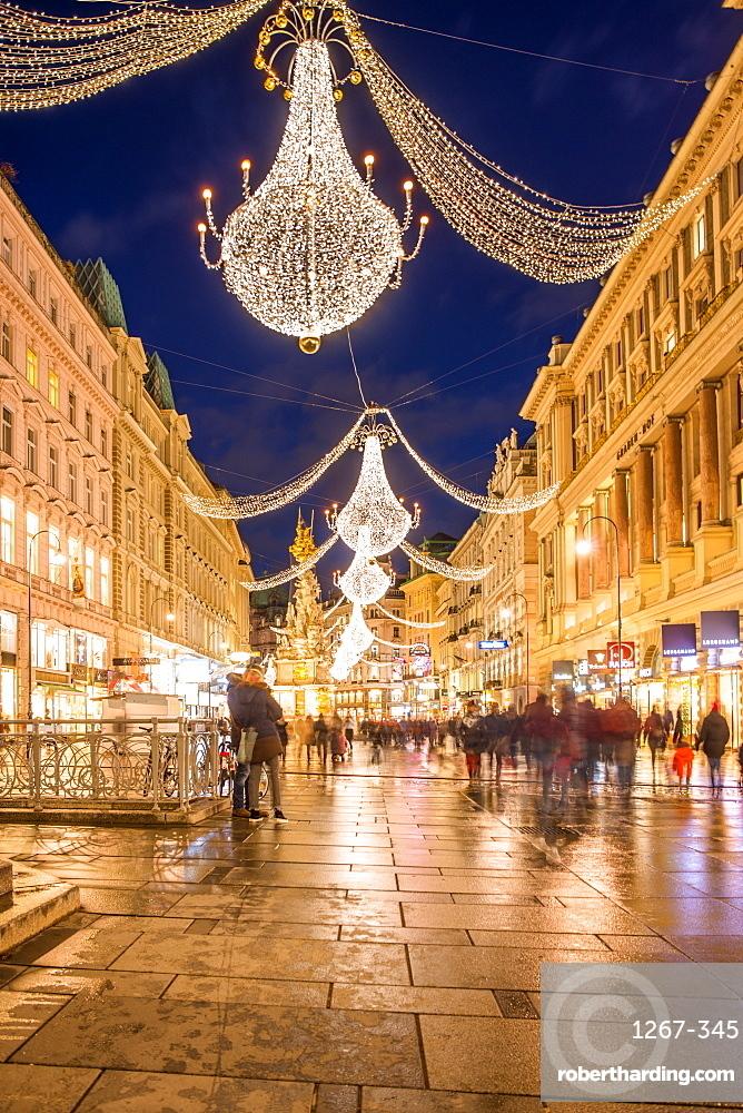 Christmas illuminations after dark on Vienna's city centre thoroughfare the Graben. Austria.