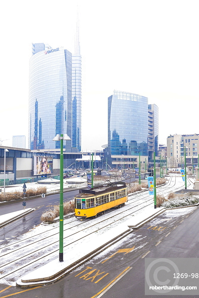 Traditional tram transit in front of skyscapers of Porta Garibaldi, Milan, Lombardy, Northern Italy, Italy, Europe