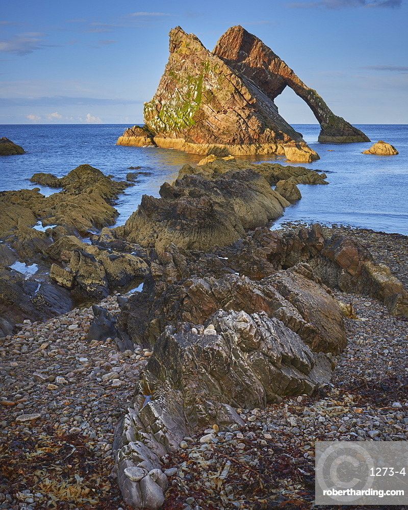 Evening light on Bow Fiddle Rock, Portknockie, Moray Coast, Scotland, United Kingdom, Europe