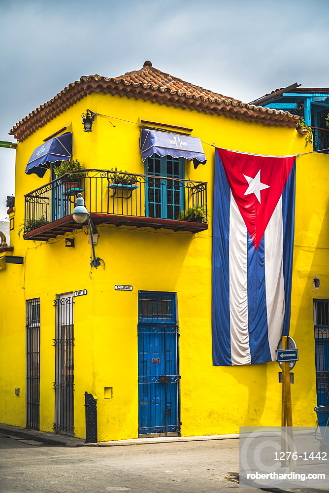 Huge Cuban flag on yellow building in Havana, La Habana, Cuba, West Indies, Caribbean, Central America
