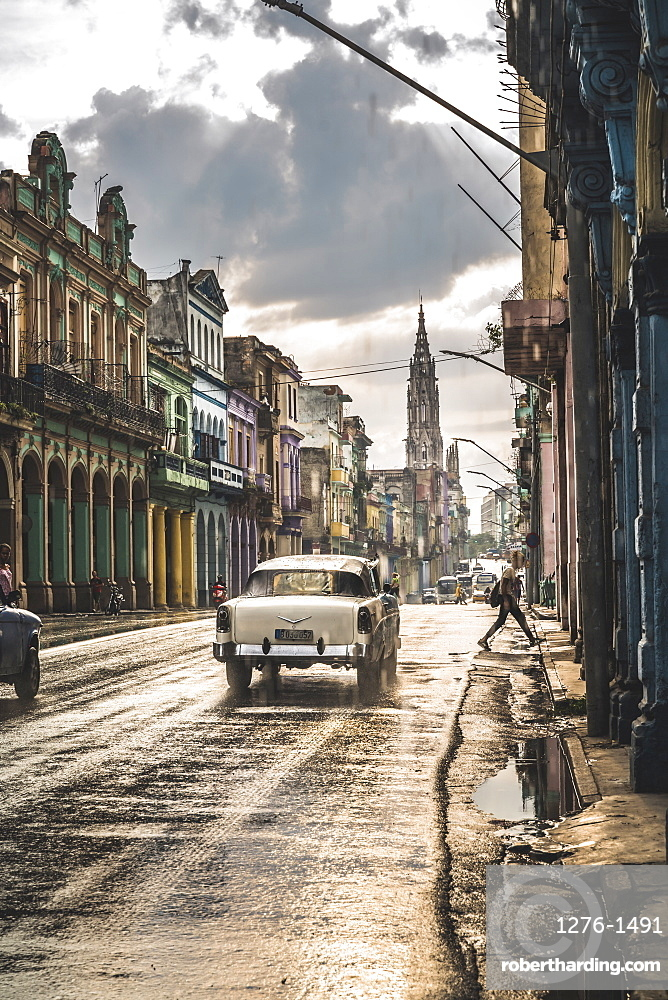 Typicall street in La Habana and cathedral in the distance in rain, Havana, Cuba, West Indies, Caribbean, Central America