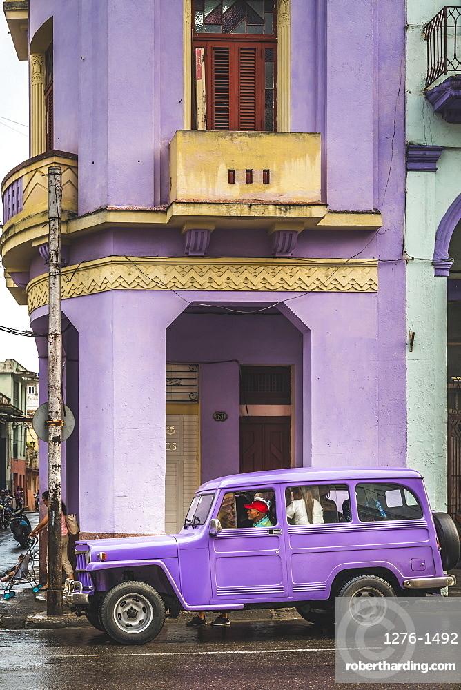 Pink building and pink vintage car in La Habana, Havana, Cuba, West Indies, Caribbean, Central America
