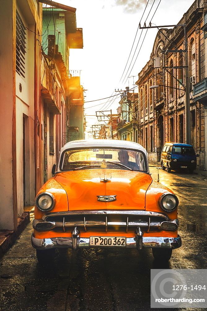 Orange American vintage car at sunset, La Habana, Havana, Cuba, West Indies, Caribbean, Central America