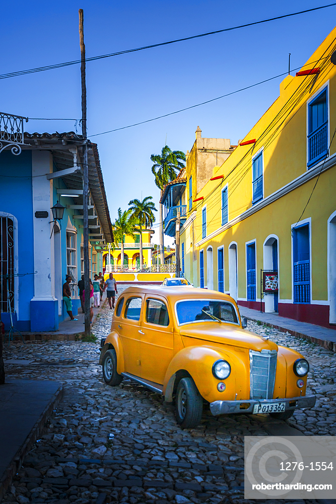 Yellow taxi in Trinidad, UNESCO World Heritage Site, Sancti Spiritus, Cuba, West Indies, Central America