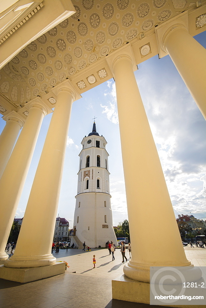 People and child walking in Cathedral Square Plaza beside the Bell Tower in Vilnius, Lithuania, Europe