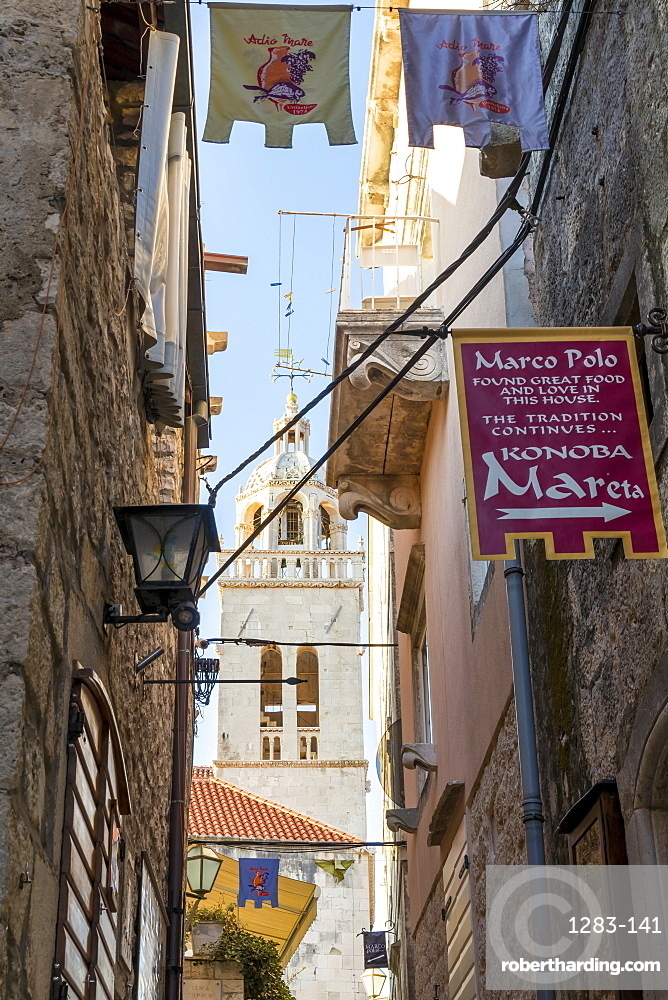 Narrow street in the old town of Korcula Town with view to the Saint Mark's cathedral, Korcula, Croatia, Europe