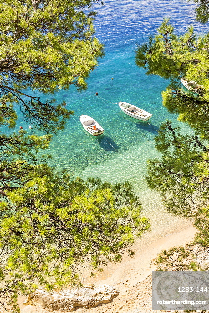 Two small boats anchored at Podrace Beach near Brela and Makarska, Croatia, Europe
