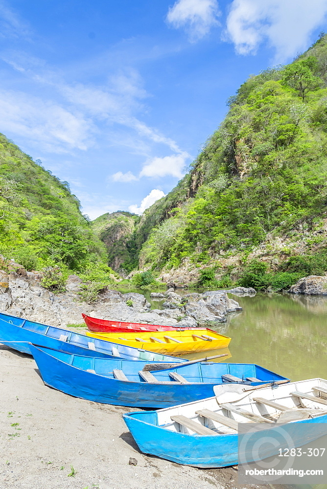 Small boats mooring at the entrance to the Somoto Canyon, Nicaragua, Central America