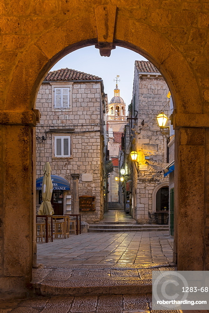 View from the town gate of the old town of Korcula to the cathedral at dawn, Korcula, Croatia, Europe