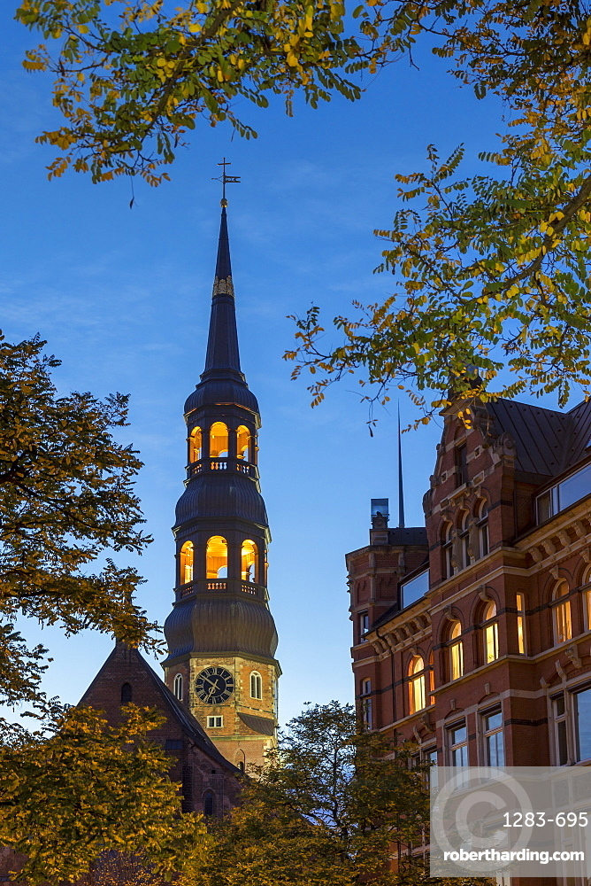 St. Catherine's Church (St. Katharinen-Kirche) and historical building at Zippelhaus during dusk, Hamburg, Germany, Europe