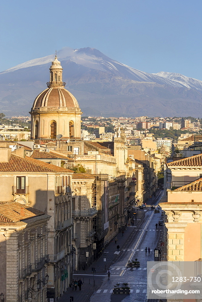 The cupula of Saint Michael church and Mount Etna in the background, Catania, Sicily, Italy, Europe