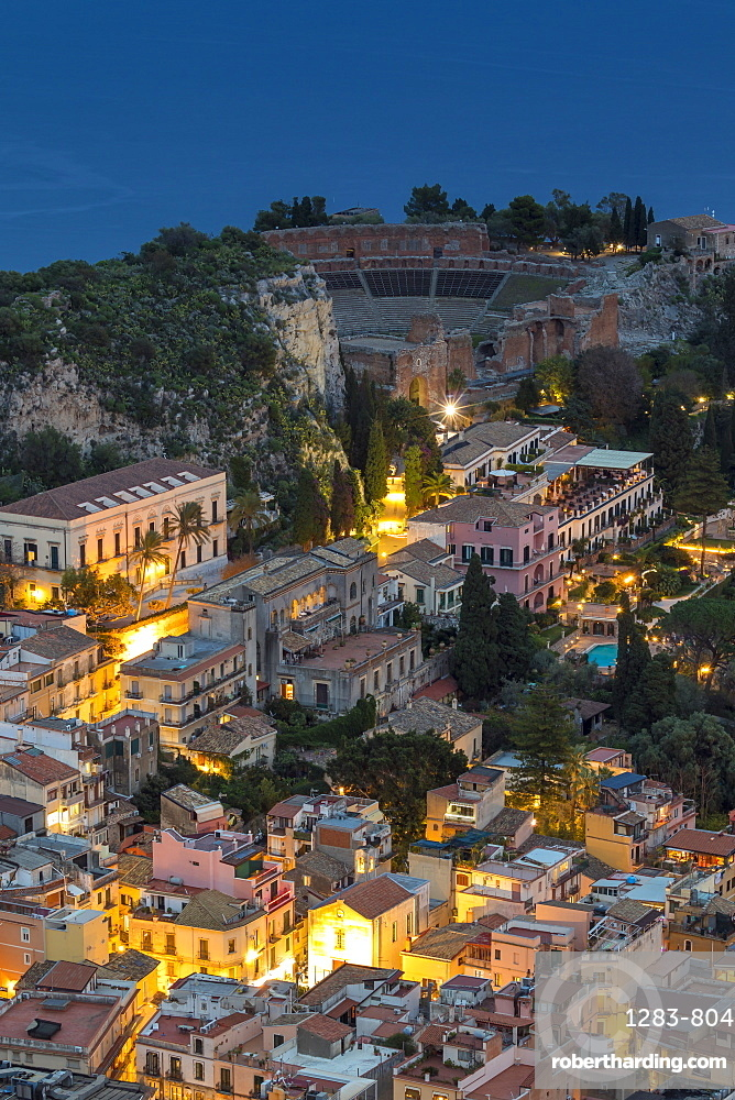 View down to the city centre and the ancient Greek Theatre at dusk, Taormina, Sicily, Italy, Europe