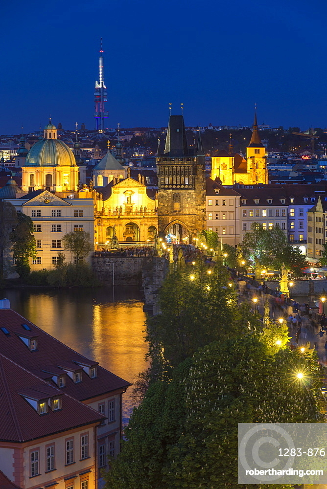 View from the Lesser Town Bridge Tower over Charles Bridge and the old town at dusk, Prague, Bohemia, Czech Republic, Europe