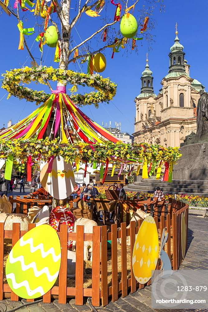Easter Market at the old town market square with St. Nicholas Church in the background, Prague, Bohemia, Czech Republic, Europe