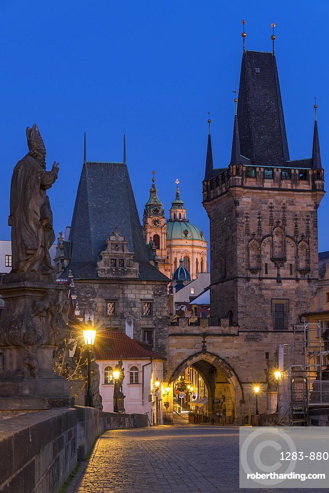The Lesser Town Bridge Tower and St. Nicholas Church seen from Charles Bridge at dawn, Prague, Bohemia, Czech Republic, Europe
