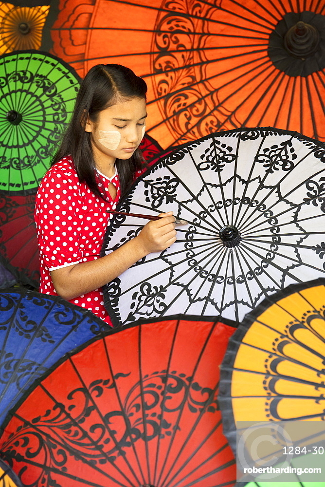 Young lady decorates colourful parasols in Bagan (Pagan), Myanmar (Burma), Asia