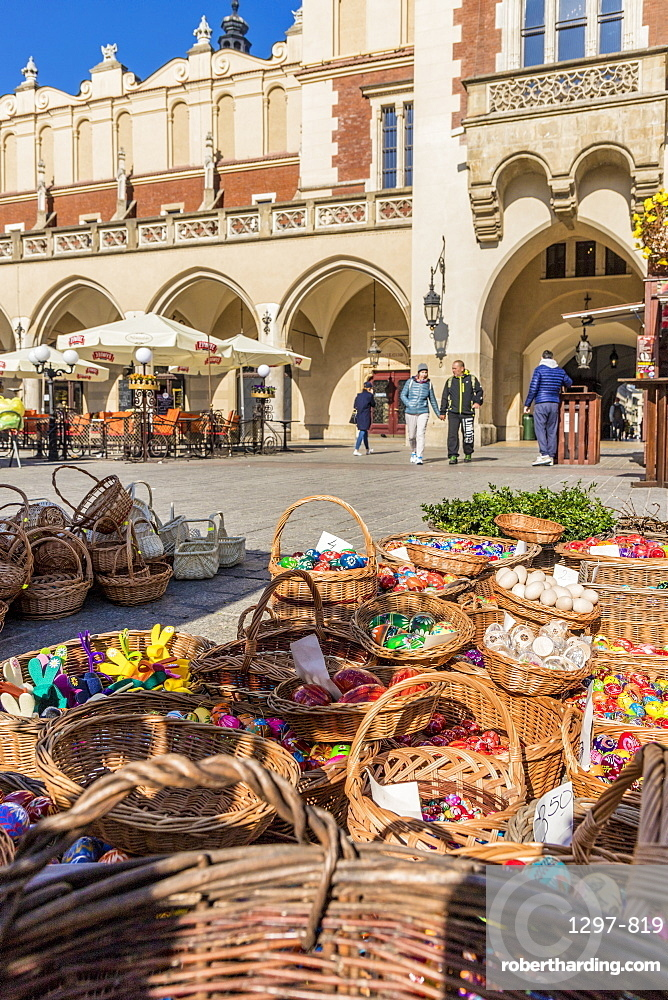 A market scene in the main square, Rynek Główny, in the medieval old town a UNESCO World Heritage site, Krakow, Poland, Europe.
