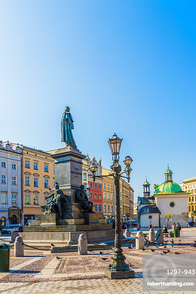 The Adam Mickiewicz Monument in the main Square in the medieval old town, a UNESCO World site, in Krakow, Poland, Europe