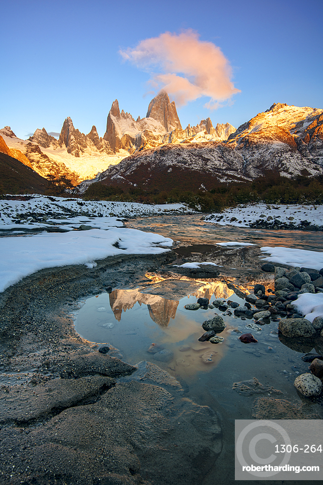 Fitz Roy at sunrise reflected in flowing river, Los Glaciares National Park, El Chaltén, Santa Cruz Province, Patagonia,