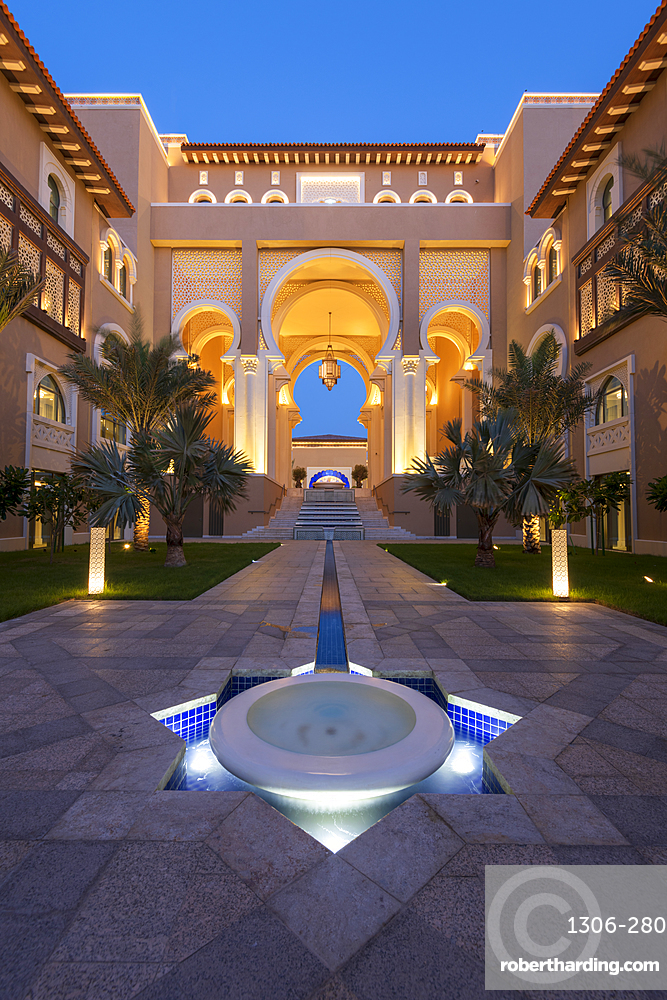 Water feature and architecture at night of luxury hotel, Saadiyat island, Abu Dhabi, UAE