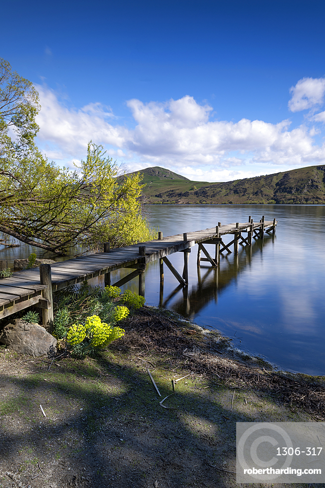 Old wooden jetty at Lake Hayes, Wakatipu Basin in Central Otago, in New Zealand