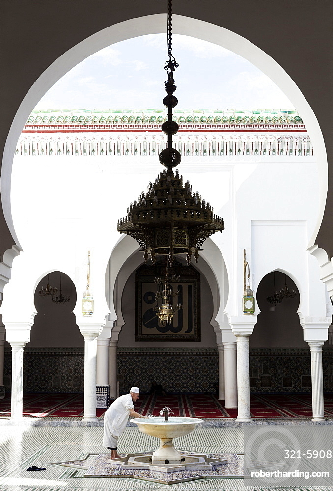 Local man washing in courtyard of Kairaouine Mosque (Mosque of al-Qarawiyyin), UNESCO World Heritage Site, Fez, Morocco, North Africa, Africa