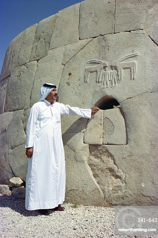 Portrait of a man in traditional dress at the Umm al Nar Tomb dating from around 2500 BC, Al Ain, near Abu Dhabi, U.A.E., Middle East