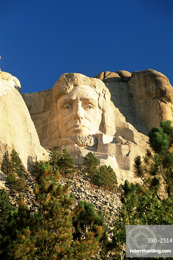 The giant head of President Abraham Lincoln, Mount Rushmore National Memorial, Black Hills, South Dakota, United States of America, North America