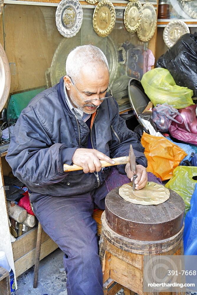 Copper worker in Copper Souq, Ghizdara Street, Tripoli, Libya, North Africa, Africa