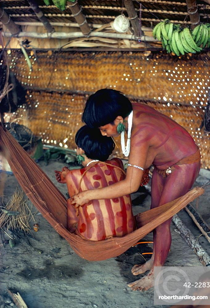 Yanomami girls applying body make-up, Brazil, South America