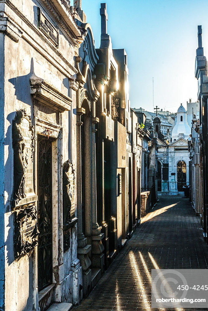 Vaults in evening sun in La Recoleta Cemetery, which lies right in the heart of the city, Buenos Aires, Argentina, South America