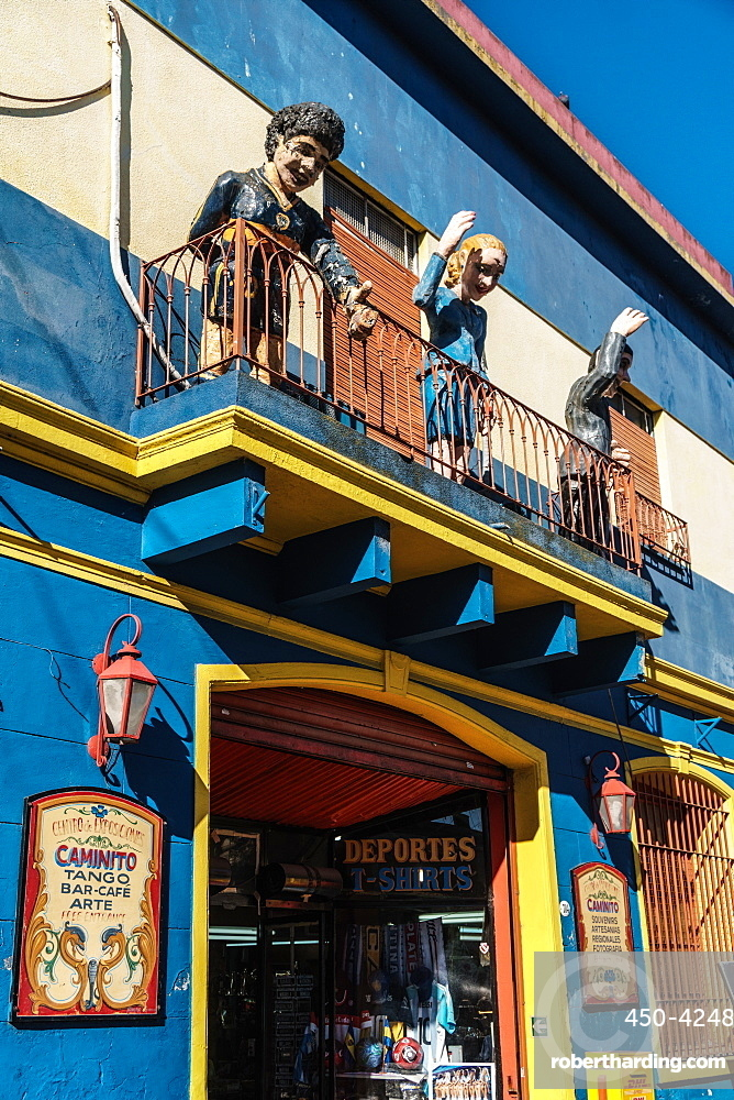 Balcony over bar on El Caminito with statues of Maradona, Evita and Gardel, a tango singer, La Boca, Buenos Aires, Argentina, South America