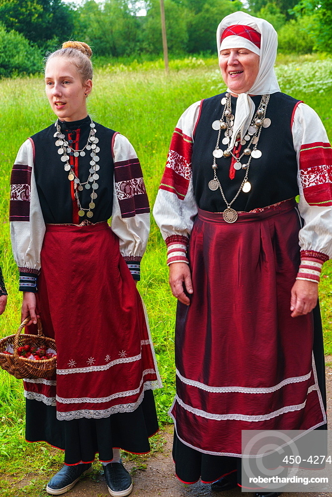 Seto mother and daughter, singing polyphonically at a Feast Day, Uusvada, Setomaa, SE Estonia, Europe