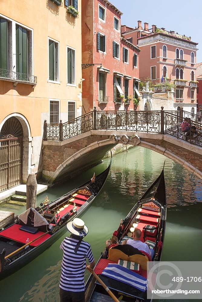 Gondola passing under a bridge over a small canal, Venice, UNESCO World Heritage Site, Veneto, Italy, Europe