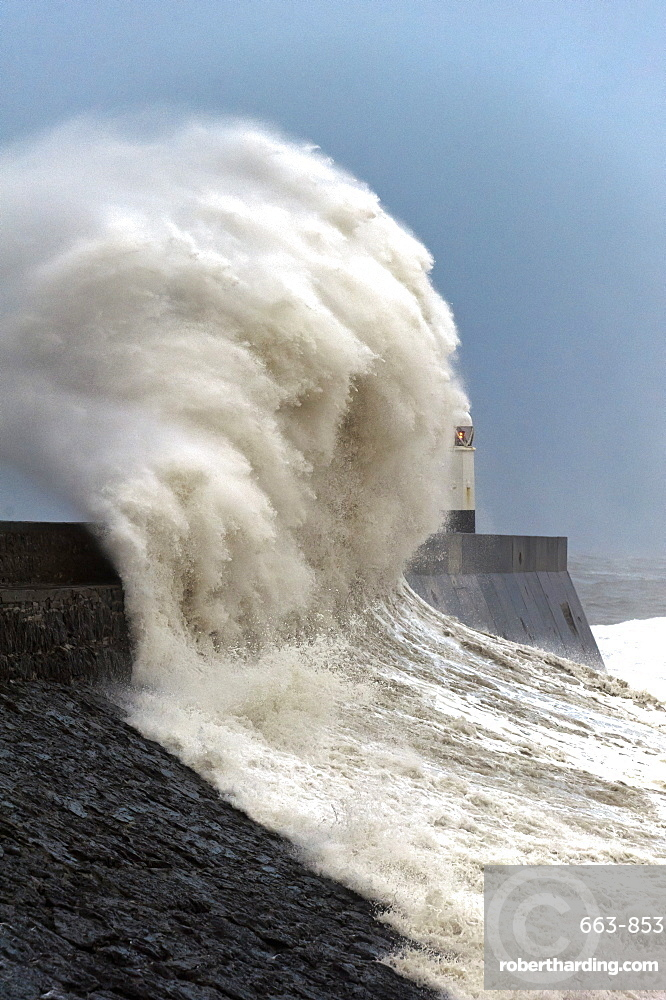 Huge waves crash against the harbour wall at Porthcawl, Bridgend, Wales, United Kingdom, Europe