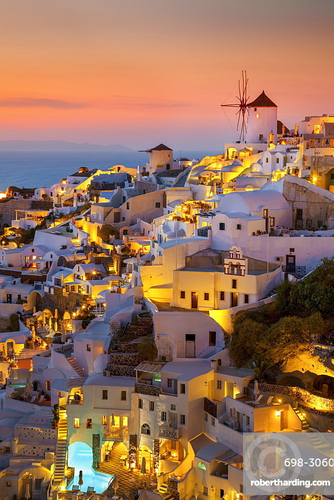 Windmill and traditional houses at sunset, Oia, Santorini (Thira), Cyclades Islands, Greek Islands, Greece, Europe