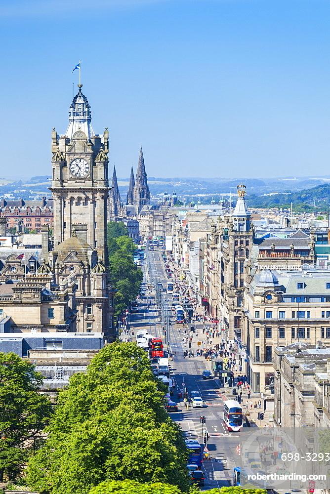 Busy traffic on Princes Street, city centre and Edinburgh skyline, Edinburgh, Midlothian, Scotland, United Kingdom, Europe
