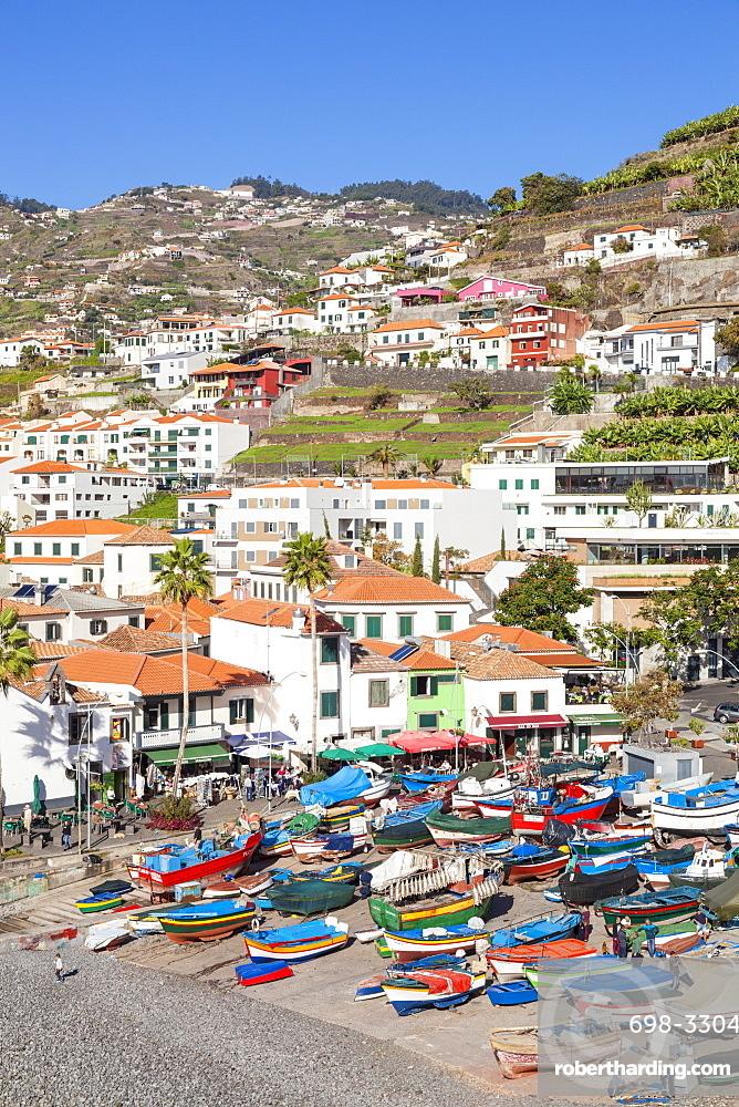 Traditional colourful fishing boats on the beach in Camara de Lobos fishing village, Madeira, Portugal, Atlantic, Europe