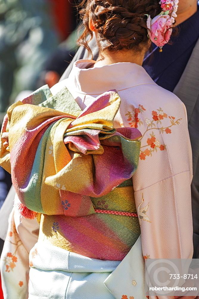 Detail of a girl wearing a kimono, Sensoji Temple, Asakusa, Tokyo, Japan, Asia