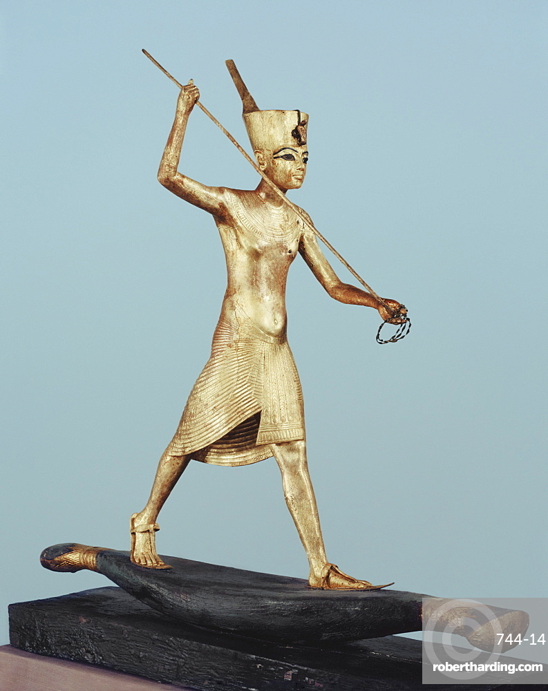 Gilt wood statuette of Tutankhamun on a boat with a harpoon, from the tomb of the pharaoh Tutankhamun, discovered in the Valley of the Kings, Thebes, Egypt, North Africa, Africa