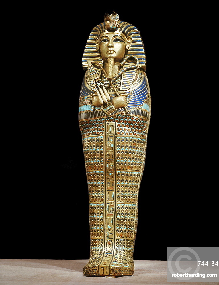 One of the four small gold mummiform coffins placed in the canopic urns, from the tomb of the pharaoh Tutankhamun, discovered in the Valley of the Kings, Thebes, Egypt, North Africa, Africa
