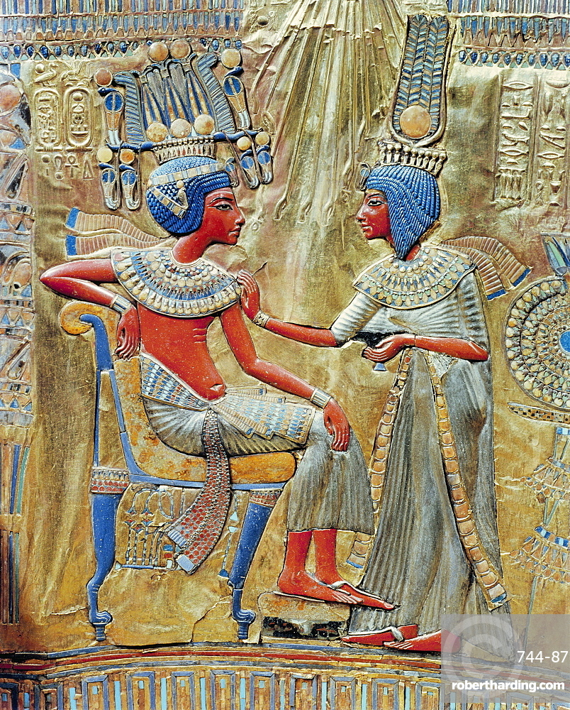 The back of the gold-plated throne, showing queen Ankhesenamun putting the finishing touches to the king's toilet, from the tomb of the pharoah Tutankhamun, discovered in the Valley of the Kings, Thebes, Egypt, North Africa, Africa