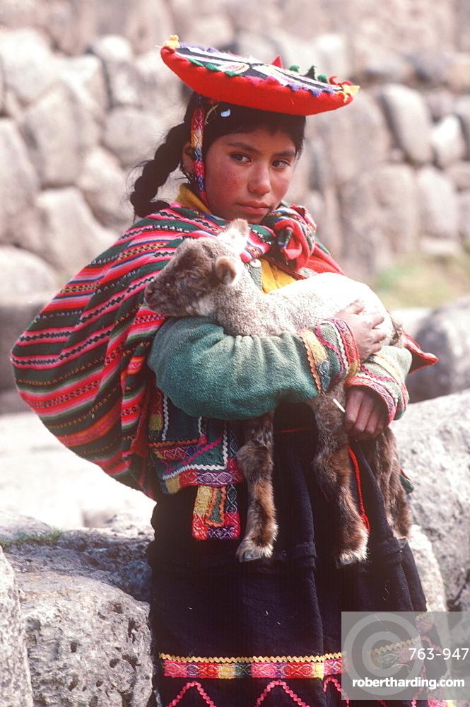 A young Quechua girl and her lamb at Tambo Machay, the ancient Incan Royal Baths near Cuzco, Peru