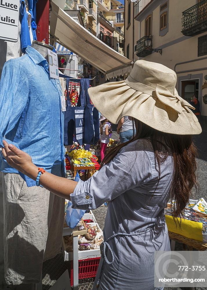 Woman shopping in the streets of Amalfi, on the Amalfi Coast, Italy.