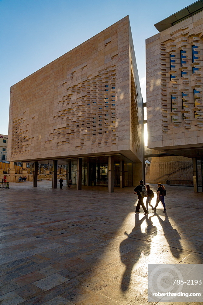People walking past Parliament House on Freedom Square in Valletta, Malta, Europe