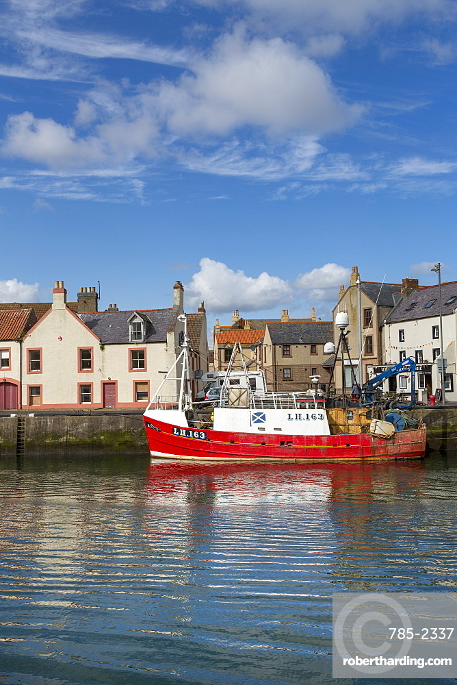 Traditional fishing boat in the sheltered harbour at Eyemouth, Berwickshire, Scottish Borders, Scotland, United Kingdom, Europe