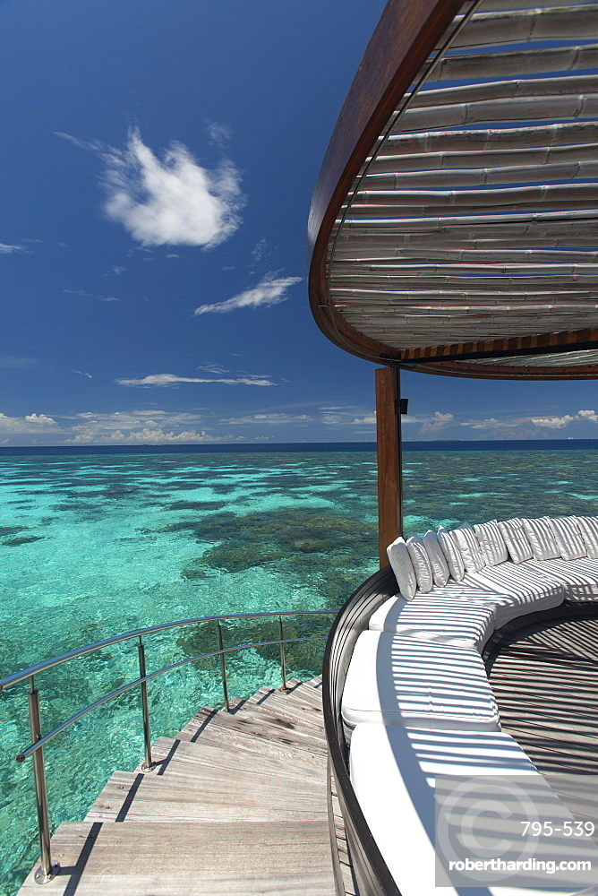 Stairs to the beach and sofa overlooking the ocean, Maldives, Indian Ocean, Asia