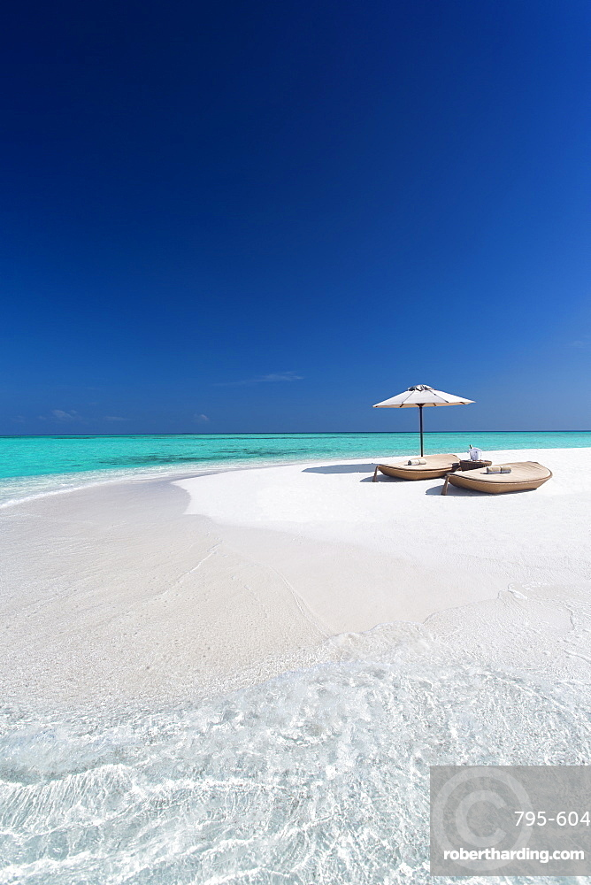 Two lounge chairs with sun umbrella on a tropical beach, The Maldives, Indian Ocean, Asia