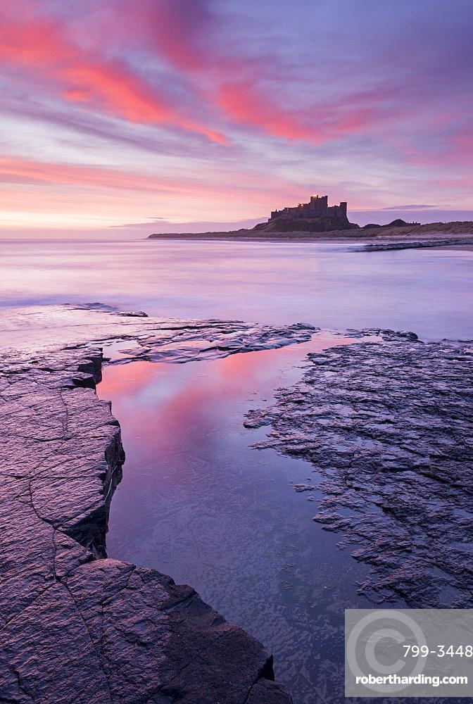 Sunrise over Bamburgh Castle on the Northumberland coast, Northumberland, England, United Kingdom, Europe
